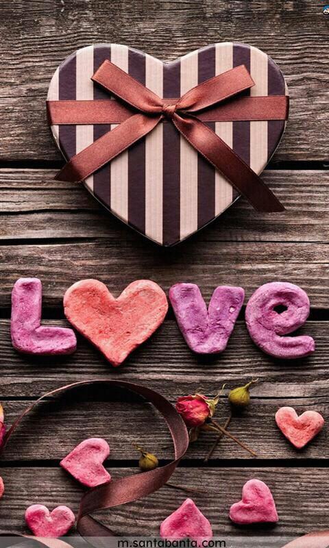 boite en forme de coeur et signe love