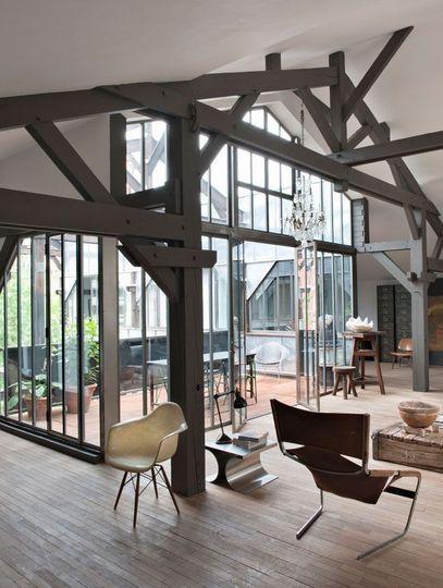 Une véranda moderne pour un loft rénové