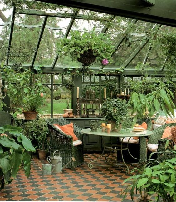 Une véranda au style anglais transfromé en jardin d'hiver